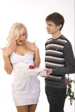 Young sexy guy and girl flirt. Isolated on white Royalty Free Stock Images