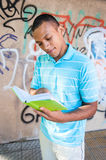 Young sexy male reading a book. Royalty Free Stock Photography