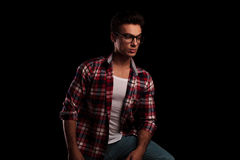 Young man in checkered shirt and glasses looking away Stock Photos