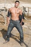 Young sexy man in desolated landscape Royalty Free Stock Photo