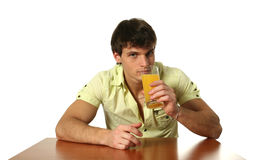 Young Sexy Man Drinking Orange Juice Stock Photos