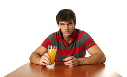 Young Sexy Man Drinking Orange Juice Royalty Free Stock Photo