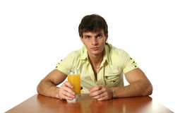 Young Sexy Man Drinking Orange Juice Royalty Free Stock Photography