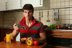Young Sexy Man Eating His Breakfast Royalty Free Stock Images
