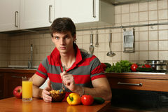 Young Man Eating His Breakfast Stock Photo