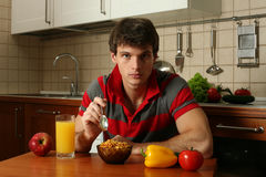 Young Sexy Man Eating His Breakfast Royalty Free Stock Photography