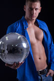 Young sexy man holding a disco ball Stock Photography