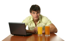 Young Man with Laptop Stock Images
