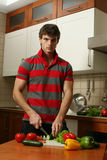Young Sexy Man Preparing Salad Royalty Free Stock Images