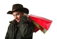 Young Sexy Man with Shopping Bags Royalty Free Stock Images