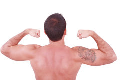 Young man showing his biceps isolated on whit Stock Photos