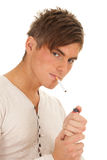 Young sexy man smoking Stock Images
