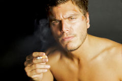 Young Sexy Man Smoking a cigarette Stock Photo