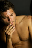 Young Sexy Man Smoking a cigarette Stock Photography