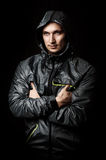Young sexy man in sport wear. Portrait of young sexy man in sport wear with hood Stock Images