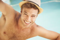 Young sexy man in swimming pool with hat Royalty Free Stock Photos