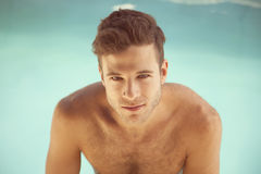 Young sexy man in swimming pool Royalty Free Stock Image