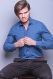 Young sexy man unbuttoning his shirt Stock Photography