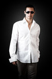 Young sexy man wearing white luxury shirt Stock Image