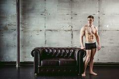 Young men bodybuilder athlete, Studio portrait