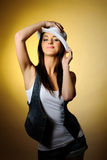 Young sexy model in jeans and white hat Stock Image