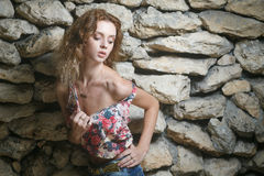 Young sexy model posing near old weathered wall Royalty Free Stock Photos
