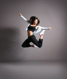 Young and modern dancer. Over grey background stock photography