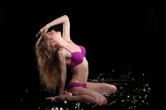 Young sexy nude woman posed wet. Water studio photo. Stock Images