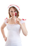 Young sexy nurse with a disposable syringe. Isolated on white Royalty Free Stock Photo
