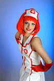 Young sexy nurse with red hair Royalty Free Stock Photography