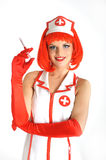 Young sexy nurse with red hair  and syringe Stock Image