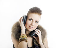 Young sexy party girl with headphones Royalty Free Stock Photography