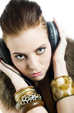 Young sexy party girl with headphones Stock Image