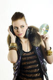 Young party girl with headphones Royalty Free Stock Photography