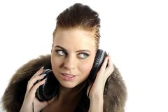 Young sexy party girl with headphones Stock Images