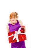 Young sexy party woman with a red big present Stock Photography
