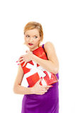 Young sexy party woman with a red big present Royalty Free Stock Photos
