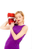 Young sexy party woman with a red big present Royalty Free Stock Photography