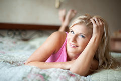 Young sexy playfull girl on a bed Royalty Free Stock Photography