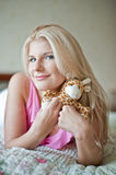 Young sexy playfull girl on a bed with toy Stock Photography