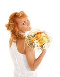Young and redhead bride with a bouquet royalty free stock photo