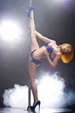 Young sexy redhead pole dance woman. Stock Images