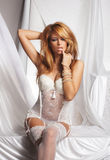 Young and sexy redhead woman in white lingerie Stock Images