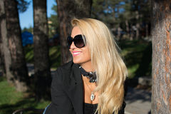 Young sexy russian girl in a park with long blond hair. Young sexy attractive business woman with long blonde hair in a park Stock Image