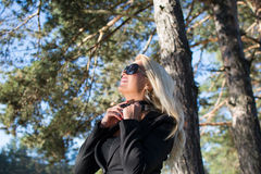 Young russian girl in a park with long blond hair. Young attractive business woman with long blonde hair in a park stock photo