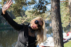 Young sexy russian girl in a park with long blond hair Stock Image