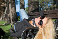 Young sexy russian girl in a park with long blond hair Royalty Free Stock Image