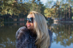 Young sexy russian girl in a park with long blond hair. Young sexy attractive business woman with long blonde hair in a park Royalty Free Stock Photos