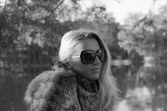 Young sexy russian girl in a park with long blond hair. Young sexy attractive business woman with long blonde hair in a park Royalty Free Stock Image