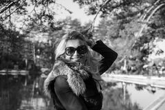 Young sexy russian girl in a park with long blond hair. Young sexy attractive woman with long blonde hair in a park Royalty Free Stock Images